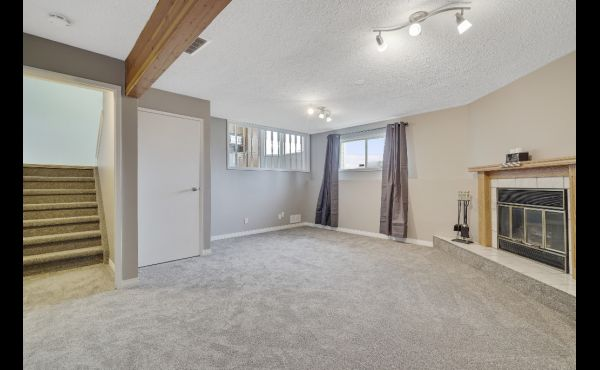 Generous family room with fireplace on third level