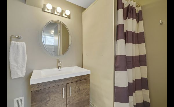 Third Full bathroom, just off family room