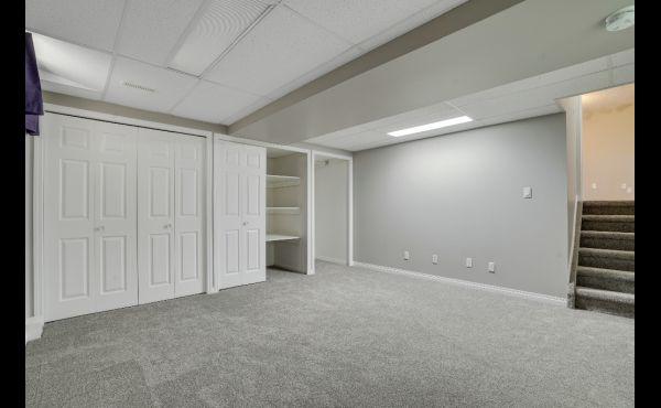 Bonus room in basement with loads of storage
