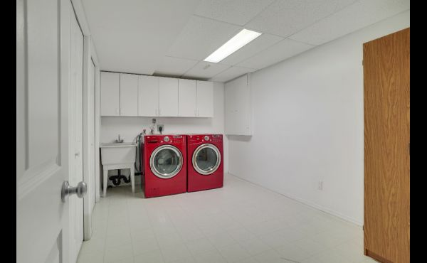 Huge laundry room with upgraded appliances