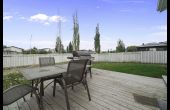 Generous yard and wooden deck